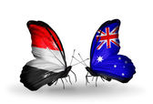 Butterflies with Yemen and  Australia flags on wings — Stock Photo