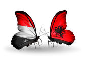 Butterflies with Yemen and  Albania flags on wings — Stock Photo