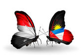 Butterflies with Yemen and  Antigua and Barbuda flags on wings — Stock Photo
