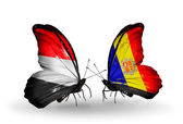 Butterflies with Yemen and  Andorra flags on wings — Stock Photo