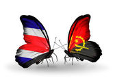 Butterflies with Costa Rica and Angola flags on wings — Stock fotografie
