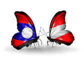 Butterflies with Laos and Austria flags on wings — Stock Photo