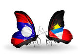 Butterflies with Laos and Antigua and Barbuda flags on wings — Stock fotografie