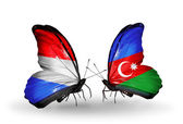 Butterflies with  Luxembourg and Azerbaijan flags on wings — Stock Photo