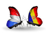 Butterflies with Luxembourg and Andorra flags on wings — Stock fotografie