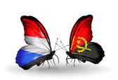 Butterflies with Luxembourg and Angola flags on wings — Stock fotografie