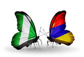 Butterflies with Nigeria and Armenia flags on wings — Stock Photo