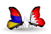 Butterflies with Armenia and  Bahrain flags on wings — Stock Photo