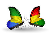 Butterflies with Gabon and  Bolivia flags on wings — Stock Photo