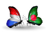 Butterflies with Luxembourg and Bangladesh flags on wings — Stock fotografie