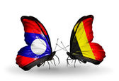 Butterflies with Laos and Belgium flags on wings — Stock Photo