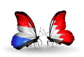 Butterflies with Luxembourg and Bahrain flags on wings — Stock fotografie