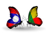 Butterflies with Laos and Benin flags on wings — Stock Photo