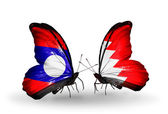 Butterflies with Laos and Bahrain flags on wings — Stock Photo