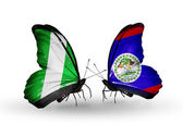 Butterflies with Nigeria and Belize flags on wings — Fotografia Stock