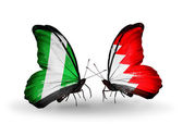 Butterflies with Nigeria and Bahrain flags on wings — Stock Photo