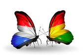 Butterflies with Luxembourg and Bolivia flags on wings — Stock Photo