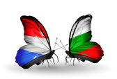 Butterflies with Luxembourg and Bulgaria flags on wings — Stock Photo