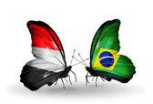 Butterflies with Yemen and  Brazil flags on wings — Foto de Stock