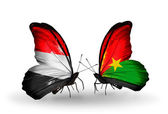 Butterflies with Yemen and  Burkina Faso flags on wings — Stock Photo