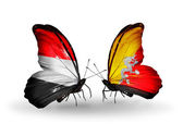 Butterflies with Yemen and Bhutan flags on wings — Foto de Stock