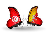 Butterflies with Tunisia and Bhutan flags on wings — Stock Photo