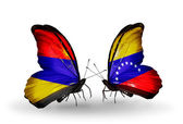 Butterflies with Armenia and  Venezuela  flags on wings — Stock Photo