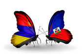 Butterflies with Armenia and  Haiti flags on wings — Stock Photo