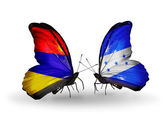 Butterflies with Armenia and  Honduras flags on wings — Stock Photo
