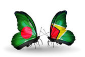 Butterflies with Bangladesh and Guyana flags on wings — Stock Photo