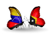 Butterflies with Venezuela and  East Timor flags on wings — Stock Photo