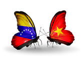 Butterflies with Venezuela and  Vietnam flags on wings — Stock Photo