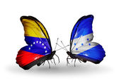 Butterflies with Venezuela and  Honduras flags on wings — Stock Photo