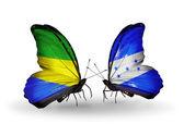Butterflies with Gabon and  Honduras flags on wings — Zdjęcie stockowe