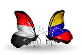 Schmetterlinge mit jemen und venezuela flaggen am flügel — Stockfoto