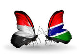 Butterflies with Yemen and  Gambia flags on wings — Stock Photo