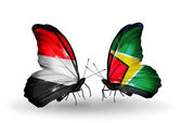 Butterflies with Yemen and  Guyana flags on wings — Stock Photo