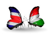 Butterflies with Costa Rica and Hungary flags on wings — Stock Photo