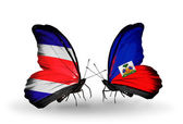 Butterflies with Costa Rica and Haiti flags on wings — Stock Photo