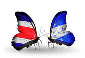 Butterflies with Costa Rica and Honduras flags on wings — Zdjęcie stockowe
