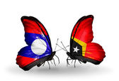 Butterflies with Laos and East Timor flags on wings — Zdjęcie stockowe