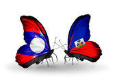 Butterflies with Laos and Haiti flags on wings — Stock Photo