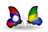Butterflies with Laos and Gabon flags on wings — Zdjęcie stockowe