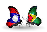 Butterflies with Laos and Guyana flags on wings — Stock Photo