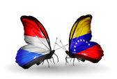 Butterflies with Luxembourg and Venezuela flags on wings — Stock Photo