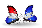 Butterflies with Luxembourg and Honduras flags on wings — Zdjęcie stockowe