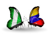 Butterflies with Nigeria and Venezuela flags on wings — Stock Photo