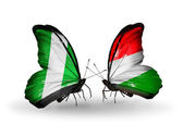 Butterflies with Nigeria and Hungary flags on wings — Stock Photo