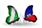 Butterflies with Nigeria and Haiti flags on wings — Zdjęcie stockowe