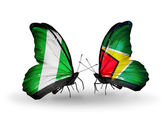 Butterflies with Nigeria and Guyana flags on wings — Stock Photo